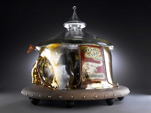 Glass series by Carrie Batista Frost. This piece is a carnival tent with an elephant inside.