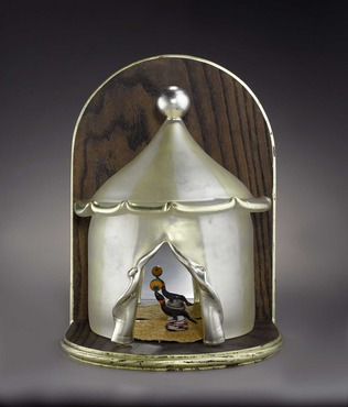Glass series by Carrie Batista Frost. This piece is a carnival tent with two seals inside.