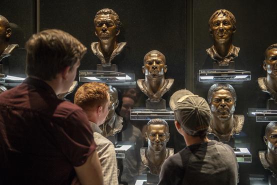 Students looking at busts