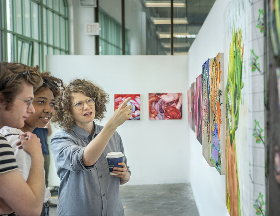 Students and visiting artist in skylit studio