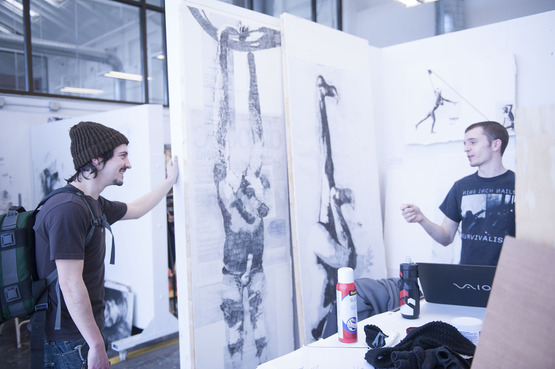 Two students chatting in the Drawing studios