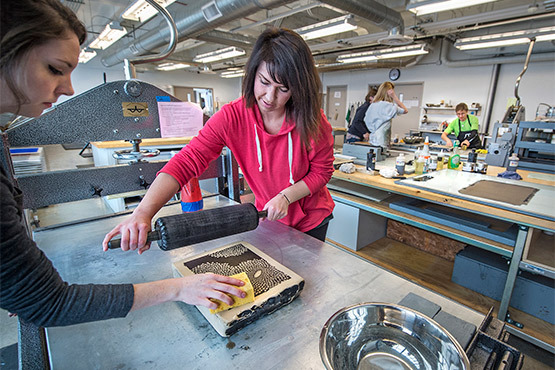 A student working in the Printmaking studio