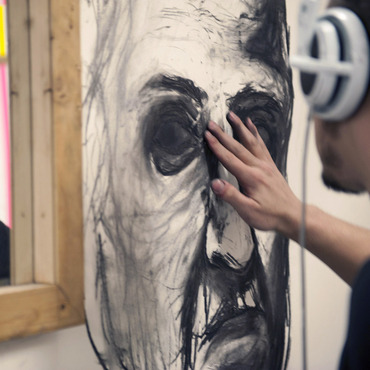 A student working on a portrait