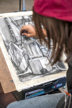A student working on a still life drawing