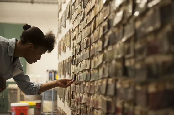 A student looking at color swatches