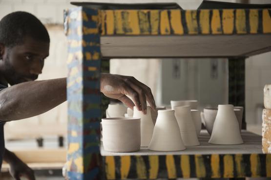 A student looking at his ceramics pieces