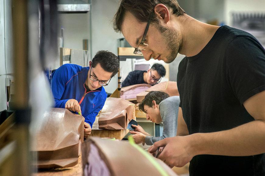 Image of industrial design students making car models