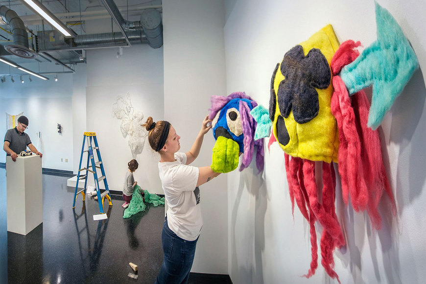 Image of students setting up a gallery