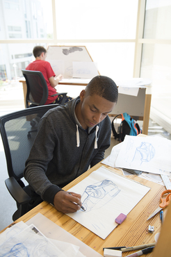 An Industrial Design student works on drafts of their design.