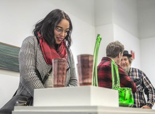Woman looking at ceramic and glass artwork