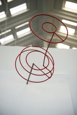 A wire sculpture of an oversized push pin created by a Sculpture student.