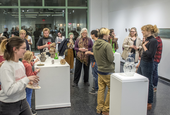 Guests enjoying Antiquity Now exhibition