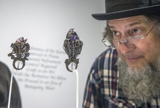 gentleman looking at jewelry in exhibition