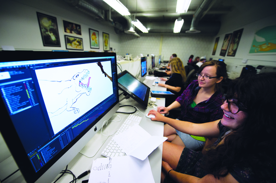 Animation students having fun in a computer lab.