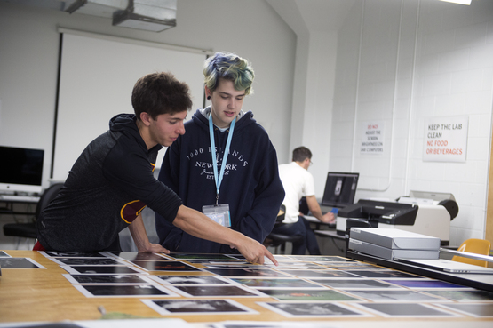 Students lay out various photographs for review.