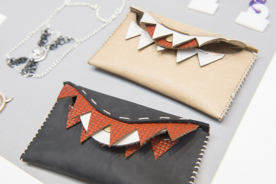 Sewn leather hand bags created by a Pre-College student.