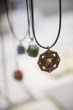 Hanging metal pendants created by a Pre-College student.