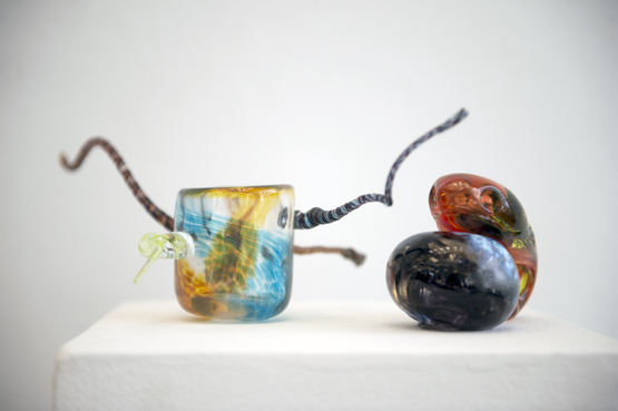 Colorful and abstract glass pieces created by Pre-College students.