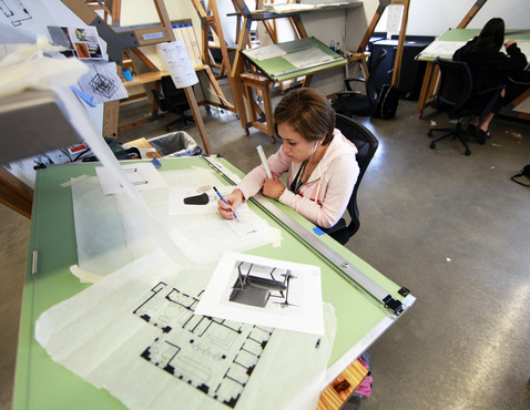 Students working in the spacious Interior Architecture and Design space.