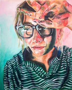 A student's colorful self portrait from the Painting class.