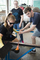 A student learns how to create a vessel in glass.