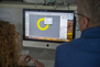 A teacher uses a computer to generate a 3D model for a jewelry piece.