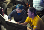 An instructor shows a Game Design student how to create game elements on a computer.