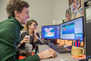 Students play testing a computer game.