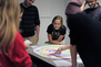 Students play testing a board game created during Pre-College.