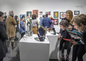 Students and families looking at artwork during the Scholastic Art and Writing exhibition.
