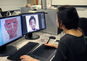 A student works on a digital self portrait during the Biomedical Art class.