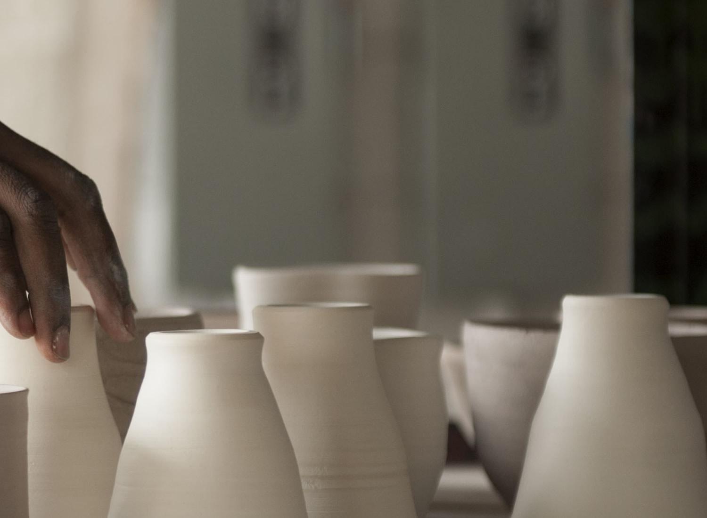 Student organizing ceramics